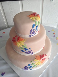 Our cake, designed by Devilish Desserts - the inside was rainbow layer cake!