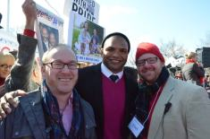 My husband, Sean and I standing with Brendon Ayanbadejo outside the Supreme Court in March